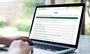 Responsive Website Design - FAQ's Page on Laptop - St Patrick's Boys' National School